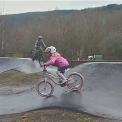 Photograph showing rider on a pump track