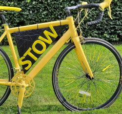 Bike painted in yellow with Stow letters